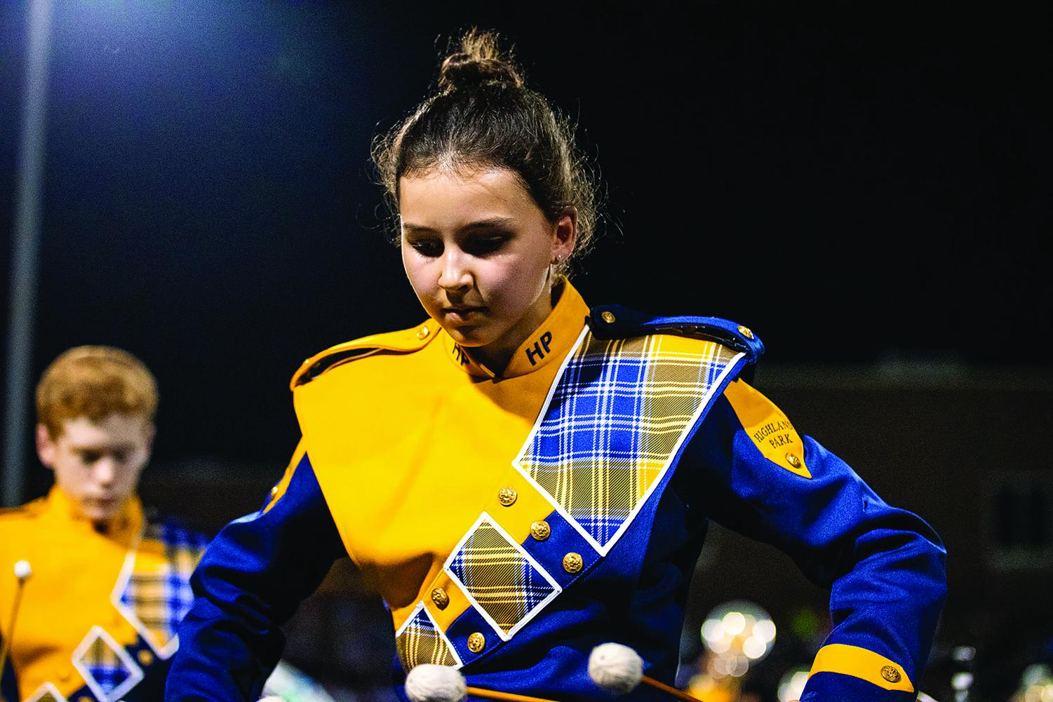 Freshman Kate Mader plays away on her Marimba during a performance of the band's 2019 production