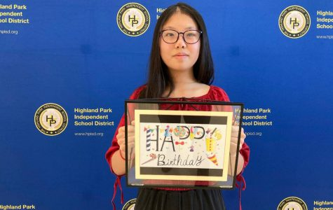 """Eighth-grader Yincheng Qian  holds her """"Sweet Birthday,"""