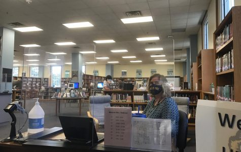 Librarian Bonny Urschel patiently waits for students to sign in as they come through the library. Students must sign in immediately upon entering the library.