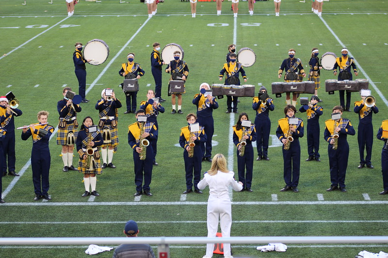 A part of Highlander Band performs at a football playoff game led by drum major Brynn Hutton. The students  that were chosen through a process that began last fall and included district, region and area levels.