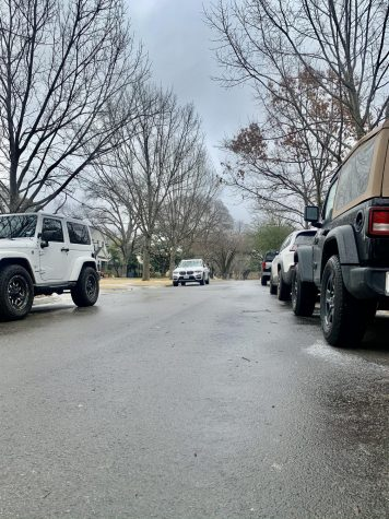 Ice can be seen on the roads under the wheels of the cars as roads are slick and slippery in University Park. Winter weather conditions developed overnight in the DFW area, causing freezing rain. Another cold front is set to blow through Monday.