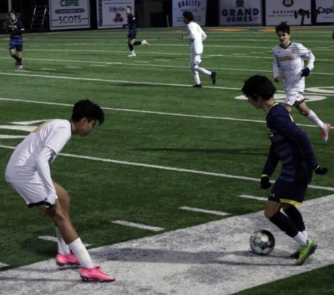 Freshman Elias Taft gains possession of the ball and figures out a strategy to get past Crandall junior Alex Ramirez. This game against Crandall took place on Feb. 9 at 7:15 p.m. and resulted in 4-1 victory.