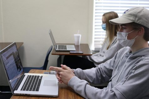 Seniors James McAnalley and Nina Kazi listen and watch their Science and Technology Festival speaker through Google Meet. McAnally signed up for a session by Dr. Giuliano Testa, Division Chief of abdominal transplant at Baylor University Medical Center.