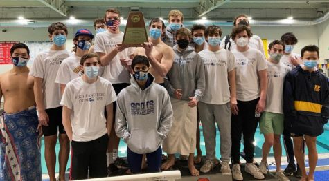 "The Blue Wave boys hold up their district championship trophy after they won the meet in all events. The team will advance to the regional meet on Feb. 6 in the Colony. ""As a team, we are very excited and are training hard to prepare for the upcoming regional meet to hopefully advance to state,"" sophomore Roman Doung said."