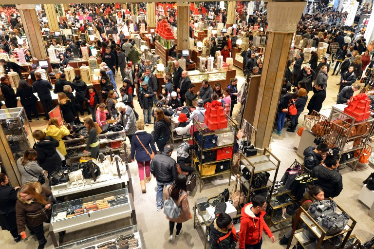 People crowd the first floor of Macy's department store as they open at midnight (0500 GMT) on November 23, 2012 in New York to start the stores'
