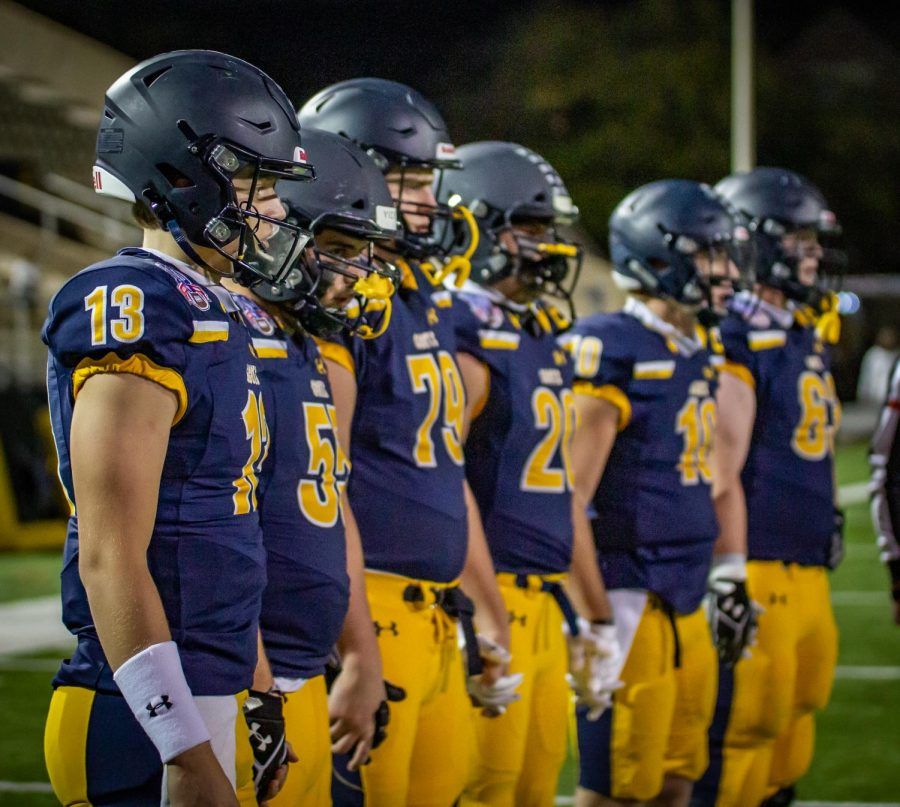 Captains+Brayden+Schager%2C+Sam+Morse%2C+Will+Gibson%2C+Patrick+Turner%2C+Marshall+Landwehr+and+Henry+Hagenbuch+line+up+before+the+game.+Both+teams+will+then+participate+in+the+coin+toss%2C+which+determines+who+gets+initial+possession+of+the+ball.+%0A