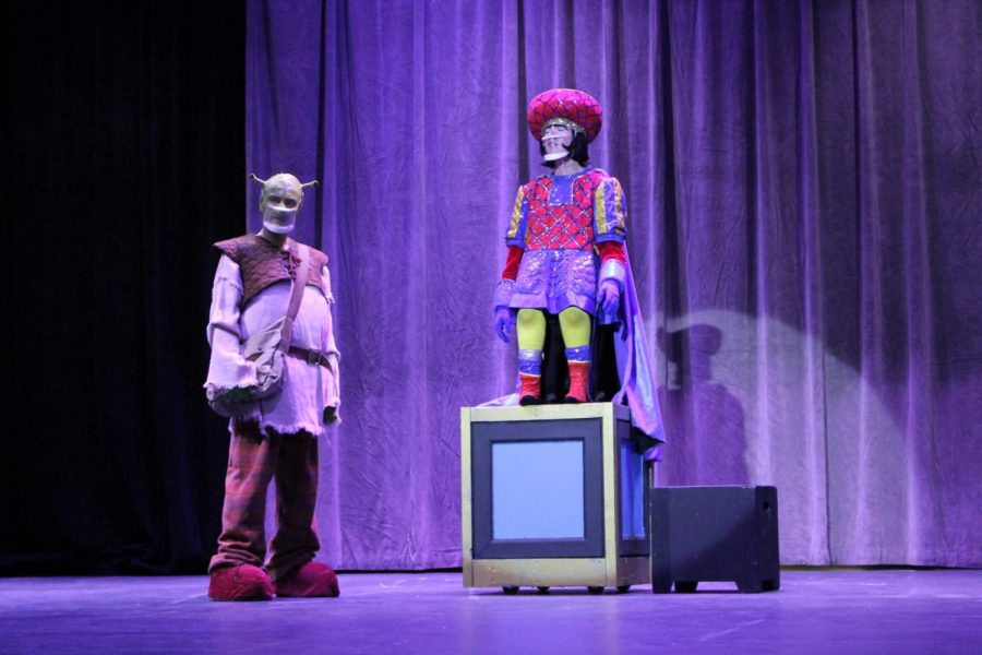Lord Farquaad, played by senior Alexander Miller, tells Shrek, played by senior JP Berry, to go find Fiona. Miller said the best part of this musical was the costumes. Theater is the first thing I began doing in high school, and I wanted to honor it by finishing senior year with Shrek. I also enjoy the rush when performing, Miller said.