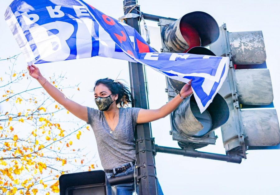 After+Joe+Biden+became+President-Elect%2C+celebrations+erupted+in+Washington+D.C.+Supporters+celebrated+by+climbing+on+light+posts+and+stoplights+waving+Biden+flags.+