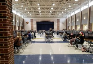 Students sit in the cafeteria after the cohort A fifth period exam. The exam day schedule was made with the intention of minimizing the amount of students in the building at once.
