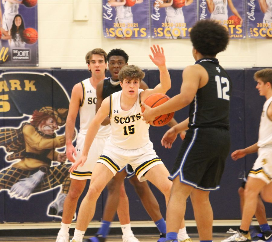 Freshmen Coleson Messer guards a player from North Forney. The opponent attempted to shoot a three-pointer but was blocked by Messer.