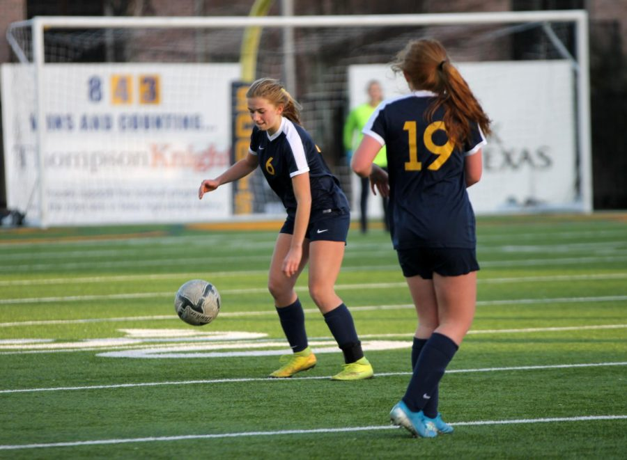 Freshman Libby Watkins  prepares to play as the ball drops back into action. She played defense.
