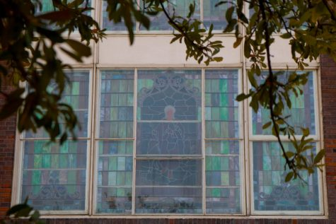 A stained glass window on the side of St. Paul United Methodist Church features a portrait of Jesus Christ. The church was founded in 1873 and is one of the last visible remnants of the Freedmantown community. The City of Dallas registered the building as a landmark in 1982.