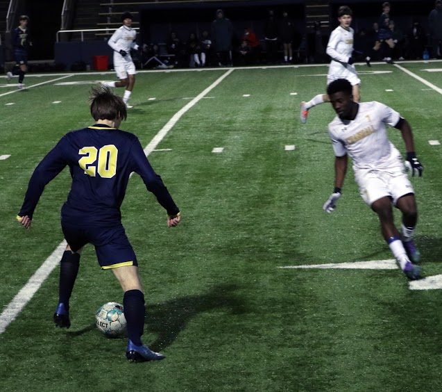 Senior Forward Matthew Sherrill grabs possession of the ball while junior Midfield Forward Phillip Olivares attempts to steal it. Sherrill then kicked the ball to his teammates to help them score.