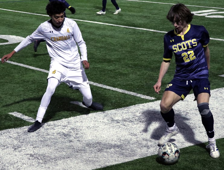 Junior Kyle French takes possession of the ball against senior Midfield Forward Manuel Vega. French was able to aim for a goal with freshman Elias Tafts help.