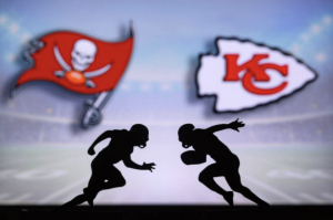 The silhouette of a Kansas City Chiefs player sprints towards a player from the Tampa Bay Buccaneers. The 2021 Super Bowl will have limited in-person attendance.