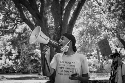 Dallas resident gives speech at a peaceful protest on Lakeside Drive Park.