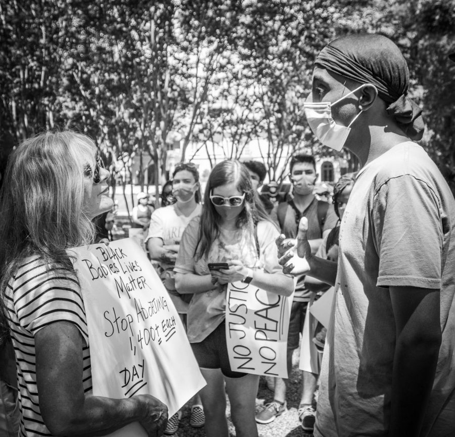 Protesters for the Black Lives Matter movement face off anti-protesters at Lakeside Drive Park. The two sides held civil discussions about their opinions and allowed for each other to protest peacefully.
