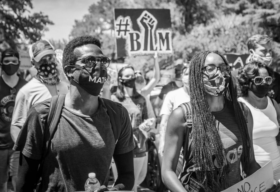Dallas residents march together down Lakeside Drive during a peaceful protest in support of the Black Lives Matter movement. Although the protests occurred in Highland Park, citizens from all over Dallas came to show their support.
