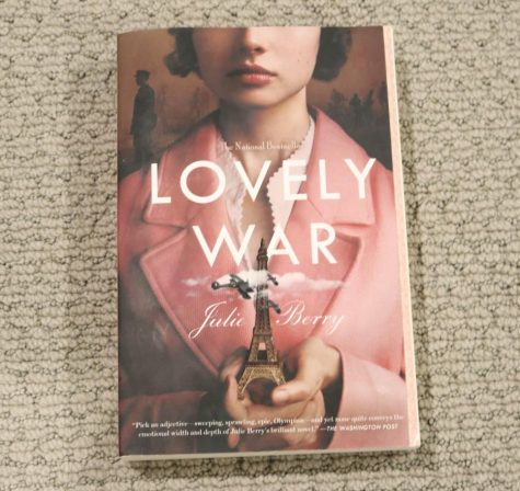 """""""Lovely War,"""" is written by Julie Berry. It tells the story of four characters, Hazel, James, Aubrey and Colette adjusting to their new life in the midst of World War I."""
