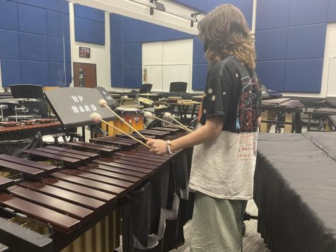 """Freshman Ava Robertson practices percussion after school. Band has gone through many changes this year that has impacted students. """"There"""