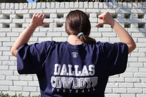 Sophomore Tia Taubenfeld points to her Cowboys' jersey. Taubenfeld is excited for the Cowboys first game of the season.