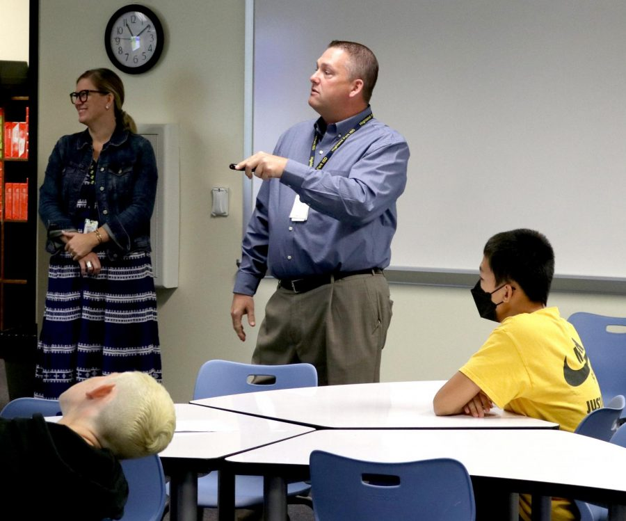 """Together, 504 Coordinator Daphne LaMontagne and Assistant Principal Troy Gray teach freshmen Yiyoung Liu and Jimmy Condos about Skyward grading on Sept. 1 in the library. The current goal of the orientation is to last at least eight weeks. """"When they first come in and the assistant principals are teaching the class, it's a little intimidating,"""" Gray said. """"The students were definitely nervous and afraid to ask questions, but I've noticed since we've started week two that they are starting to open up a little bit more and ask questions."""""""